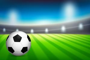 Uma bola de futebol no estádio