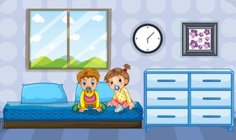 Boy and girl toddlers on blue bed
