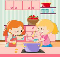 Two girls making soup in the kitchen