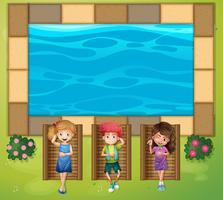 Três crianças se divertindo na piscina