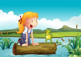 A girl with a frog in the river