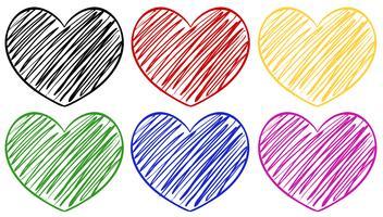 Seis corazones en diferentes colores.