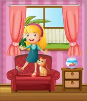 A girl and a cat in a sofa
