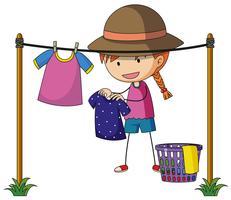 Girl doing laundry outside
