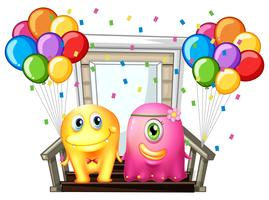 Two monsters and colorful balloons