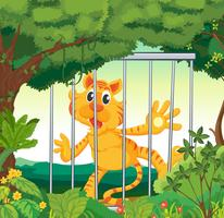 Un bosque con un tigre dentro de una jaula.
