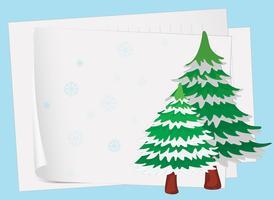 Papierblätter und ein Weihnachtsbaum