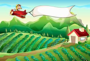 Een piloot met een lege banner die boven de boerderij vliegt