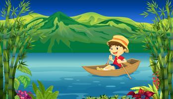 Um menino sorridente em um barco