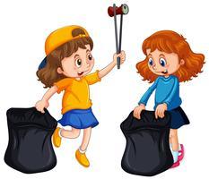 Två tjejer plockar upp papperskorgen