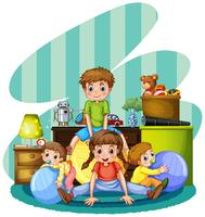 Cuatro niños jugando en la habitación.