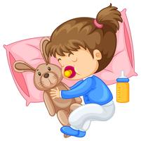 Kleines Mädchen, das Kaninchen im Bett umarmt