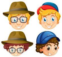 Vier gezichten van jongens die hoeden dragen