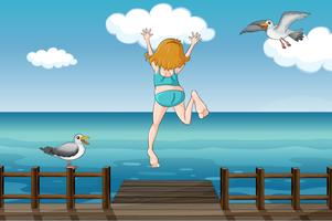 Uma menina pulando em uma água