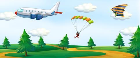 Mensen met luchtactiviteit en landschap
