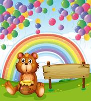 A bear sitting beside the empty board with balloons and a rainbow