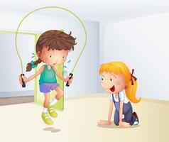 A girl playing jumping rope inside the room