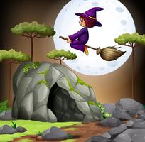 Witch flying over the cave