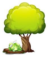 Een groen driemogig monster dat degelijk onder de boom slaapt