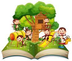 Apa i parken öppen bok