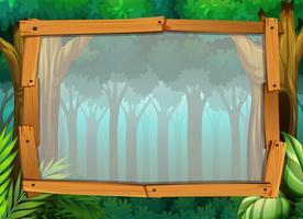 Gränsdesign med mörk skog