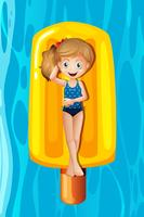Young girl relaxing on popsicle inflatable