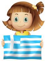Ragazza carina che tiene la bandiera della Grecia