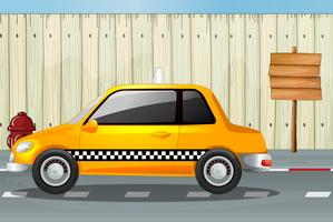 Um carro, um hidrante e um quadro de avisos