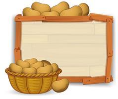 Potato on wooden board