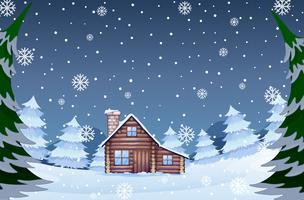 Casa nella foresta invernale