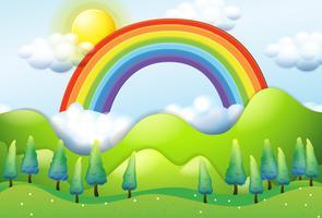 Schöner grüner Berg und Regenbogen