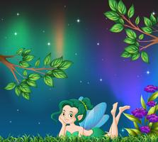 Cute fairy in garden at night
