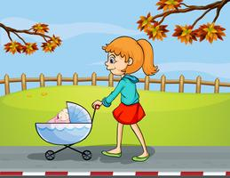 A girl pushing a stroller with a sleeping baby