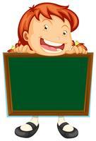 Girl holding blank blackboard