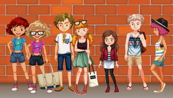 Hipster boys and girls hanging out on the street