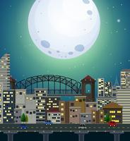 A giant full moon city scene