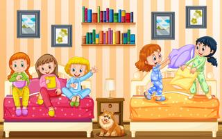 Fem tjejer leker i sovrummet