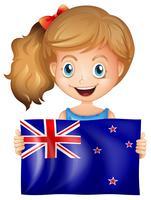 Glad tjej med flagga i Nya Zeeland