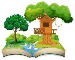 Capanna sull'albero naturale sul libro aperto