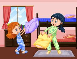 Two girls playing pillow fight in bedroom