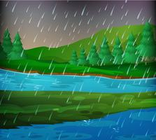 Rivierscène op regenachtige dag