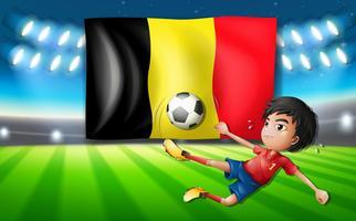 De voetbalspeler die van België een bal schopt