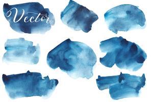 Set med akvarellfärg. Platser på en vit bakgrund. Akvarelltextur med penselsträckor. Abstraktion. Blå, turkos, indigo, svart. Hav, himmel. Isolerat. Vektor.