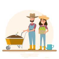 homme et femme plantant des légumes à l'intérieur de la ferme