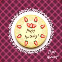 Crème verjaardagstaart versierd met aardbeien
