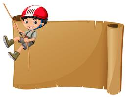 Paper template with boy climbing rope