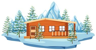 Casa de madeira no campo de neve