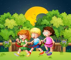 Three kids outdoor walking in the middle of the night