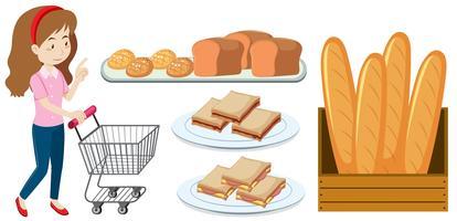 Frau mit Einkaufswagen und Brot