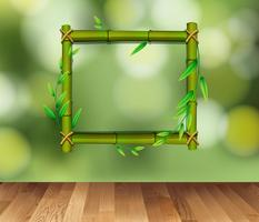 Bamboo frame on green background